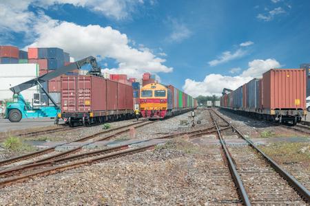 Photo pour Cargo train platform with freight train container at depot - image libre de droit