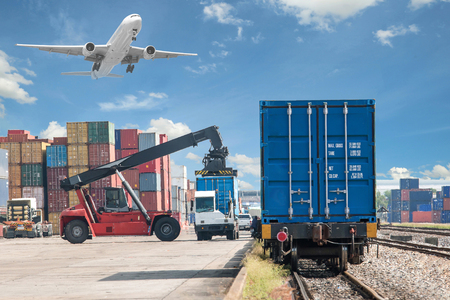 Photo for forklift handling container box loading to freight train - Royalty Free Image