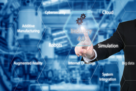 Foto de Business man touching industry 4.0 icon in virtual interface screen showing data of smart factory. Business industry 4.0 concept. - Imagen libre de derechos