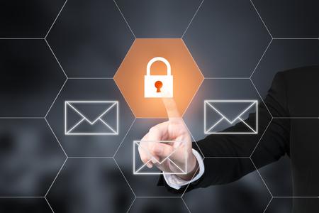 Foto de Businessman pressing e-mail security button on virtual screens. Use for business technology internet concept - Imagen libre de derechos
