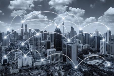 Foto de Network business conection system on Kuala Lumpur city in background. Network business conection concept. - Imagen libre de derechos