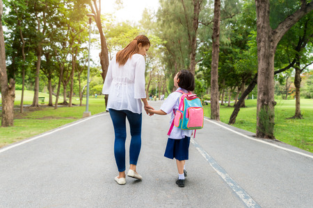 Photo for Asian mother and daughter student walking to school.Pupil student. - Royalty Free Image