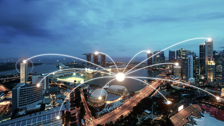 Foto de Network business conection system on Singapore smart city scape in background.Network business conection concept - Imagen libre de derechos