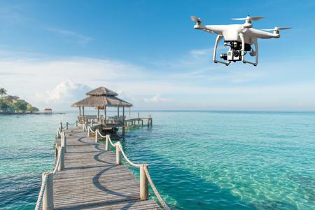 Foto de Drone with high resolution digital camera flying over tropical sea in background in Phuket, Thailand. Beautiful landscape - Imagen libre de derechos
