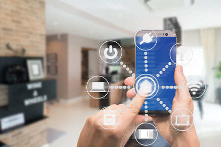 Photo pour Smart home automation app on mobile with home interior in background. Internet of things concept at home. Smart technology 4.0 - image libre de droit