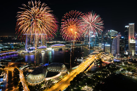 Photo pour Aerial view of Fireworks celebration over Marina bay in Singapore. New year day 2018 or National day celebration at Singapore. Asia - image libre de droit