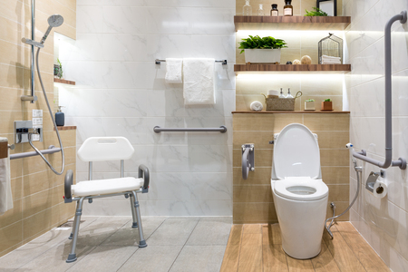 Foto de Interior of bathroom for the disabled or elderly people. Handrail for disabled and elderly people in the bathroom - Imagen libre de derechos
