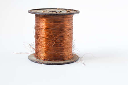 Foto de Copper wire on spool, isolated on white backgrounds, with clipping paths on white background - Imagen libre de derechos