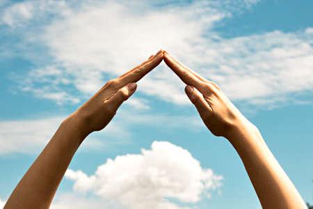 Foto de The combined hands, are forming a triangle - Imagen libre de derechos