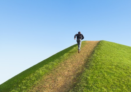 Photo pour Pathway up the hill against the sky. Man ran to the top. Symbol development or career growth. - image libre de droit