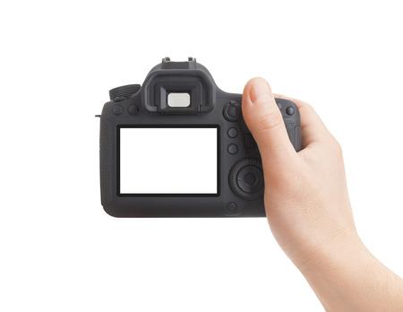 Foto de Camera in hand on white background - Imagen libre de derechos