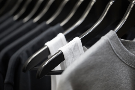 Foto de sports clothing on hangers, abstract background - Imagen libre de derechos