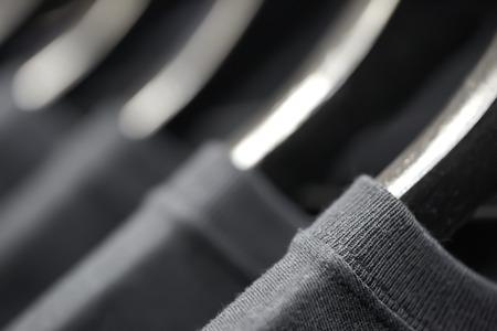 Foto de sports clothing on hangers in the shop, abstract background - Imagen libre de derechos