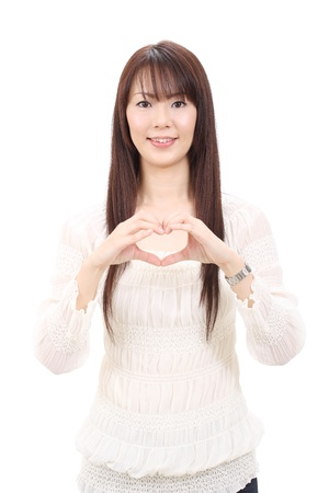 Young asian woman showing a heart with her fingers