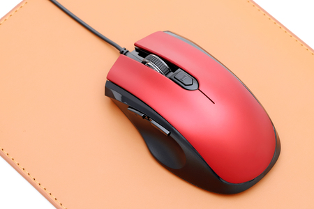 Computer mouse and mouse pad isolated on white background