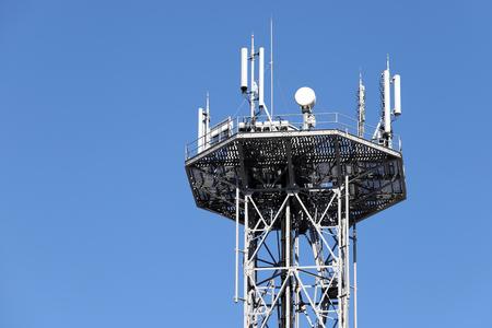 Photo pour View of communications tower against blue sky  - image libre de droit