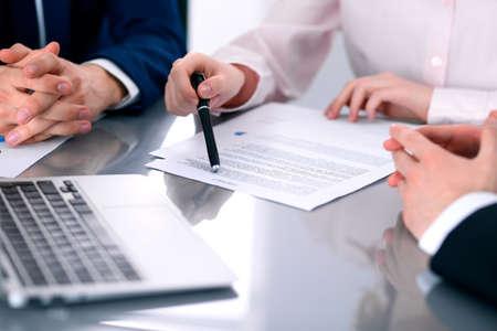 Foto de Group of business people and lawyers discussing contract papers - Imagen libre de derechos
