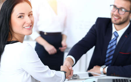 Photo pour Business handshake at meeting or negotiation in the office. Two businesspeople partners are satisfied because signing contract or financial papers - image libre de droit