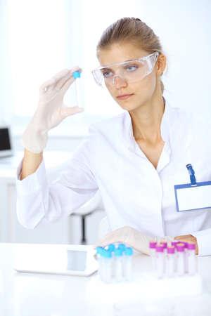 Foto de Female scientific researcher or blood test assistant in laboratory. Medicine concept - Imagen libre de derechos