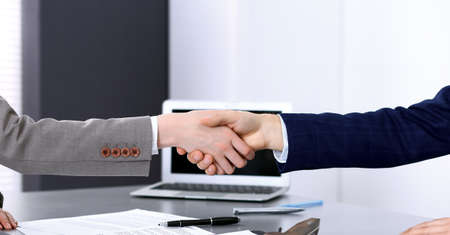 Photo for Business people shaking hands, finishing up a meeting. Papers signing, agreement and lawyer consulting concept - Royalty Free Image