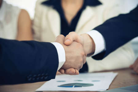 Photo pour Business people shaking hands at meeting or negotiation in the office. Handshake concept. Partners are satisfied because signing contract. - image libre de droit