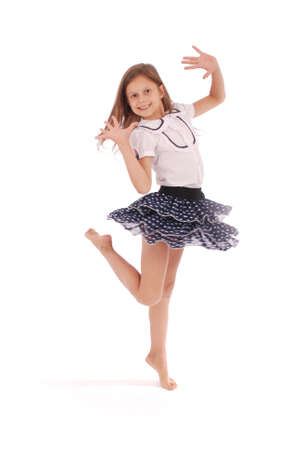 Photo pour Happy young girl dancing isolated on white background - image libre de droit
