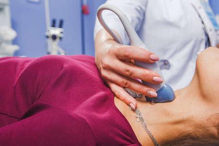 Foto de Young Woman Doing Neck Ultrasound Examination At Hospital - Imagen libre de derechos