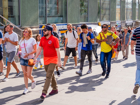 Photo for MOSCOW, RUSSIA - July 01, 2018. Tourists and local football fans walking on Nikolskaya street before game Russia-Spain (FIFA World Cup 2018). - Royalty Free Image