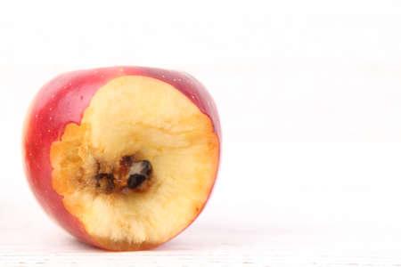 Foto de A good and bitten red apple rotten from inside isolated white background - Imagen libre de derechos