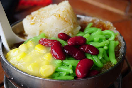 Photo for Cendol Desert. Asian favourite iced dessert of rice flour and pandanus jelly with coconut milk and palm sugar - Royalty Free Image