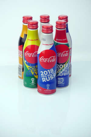 Foto de KUALA LUMPUR, MALAYSIA -July 4th 2018: Close up of a Special edition collectable coca cola can from previous year, France, Korea, Germany, Brazil, South Africa and for FIFA World Cup 2018 in Russia with other world cup bootle isolated white background - Imagen libre de derechos