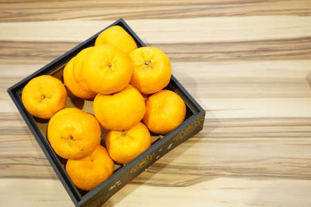 Photo pour Mandarin oranges or Lokam over wooden background for Chinese New Year celebration - image libre de droit
