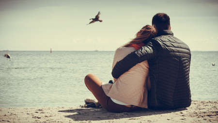 Photo for loving couple spending leisure time together at beach hugging rear view - Royalty Free Image
