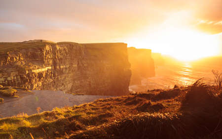 Photo pour Famous cliffs of Moher at sunset in Co. Clare Ireland Europe. Beautiful landscape natural attraction. - image libre de droit