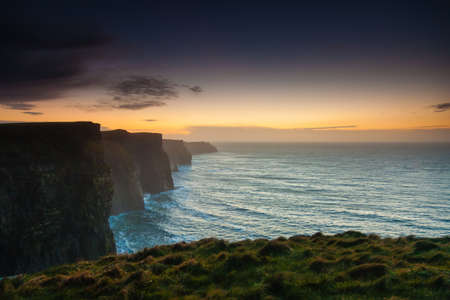Photo for Famous cliffs of Moher at sunset in Co. Clare Ireland Europe. Beautiful landscape natural attraction. - Royalty Free Image