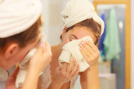 Photo pour Woman cleaning washing her face with clean water in bathroom. Girl taking care of her complexion. Morning hygiene. Skincare treatment - image libre de droit