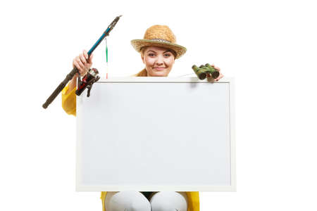 Photo pour Fishery, spinning equipment, angling sport and activity concept. Happy woman with fishing rod holding blank white board with copyspace. - image libre de droit