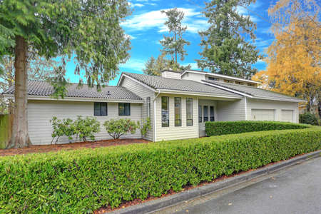 Photo for Nicely remodeled home exterior with boxwood hedge plus two garage spaces. - Royalty Free Image