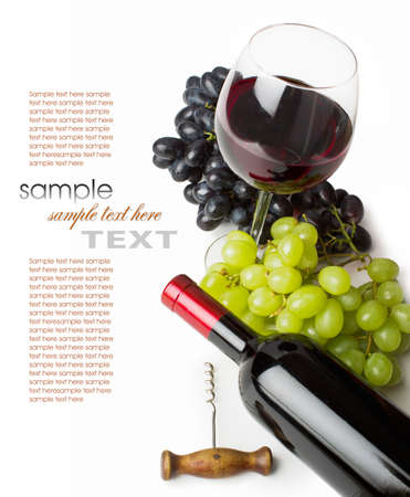 Foto de glass of red wine with bottle and grapes on a white background - Imagen libre de derechos