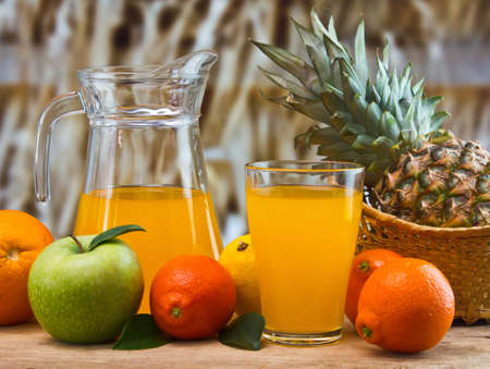 orange juice in a glass on a table with oranges