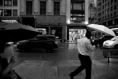 Walking under the rain in New York City