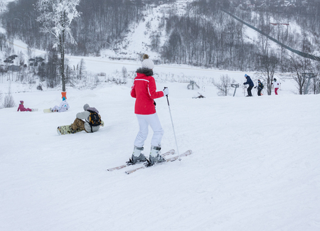 Photo pour MOSCOW, RUSSIA - JANUARY 25, 2015: Ski club Leonid Tyagachev-oldest ski resort in Moscow region and training base for Russian national teams.Young women to roll downhill on slope on alpine skis - image libre de droit