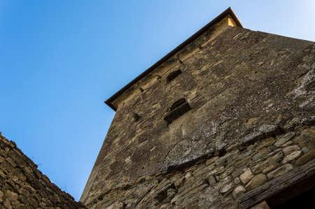 Photo pour Detail of a dark ancient medieval tower - image libre de droit