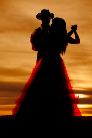 Photo for A western silhouette of a couple dancing together. - Royalty Free Image