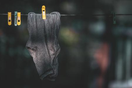 Foto de Black one socks hang drying on the clothesline - Imagen libre de derechos