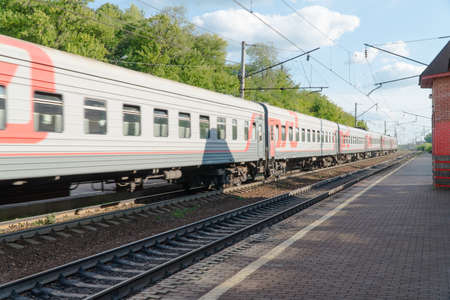 Foto per passenger train on the railway against the sky - Immagine Royalty Free