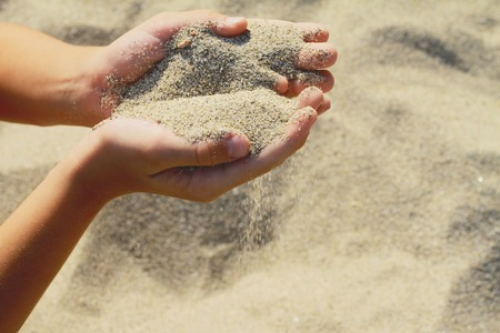 Photo for Close up onChilds hands holding sand.summer beach holiday vacation concept - Royalty Free Image