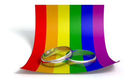 A marriage or engagement concept showing two wedding bands on a curled paper note colored in the gay rainbow flag colors an isolated white background