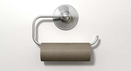 An emptied roll of toilet paper hanging on a chrome toilet roll holder on an isolated white textured background