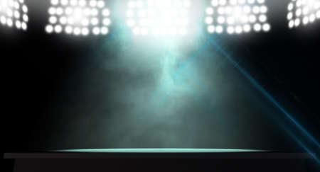 An stage lit by a single spotlight on a dark